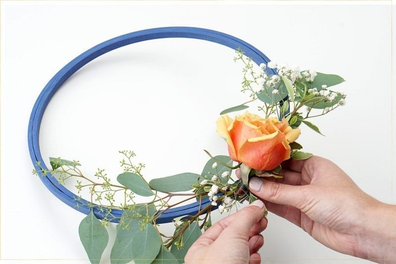 Step 3:  Add flowers to the hoop.