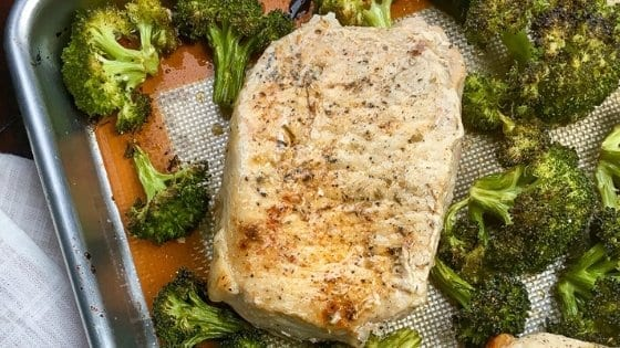 Up close view of boneless pork chops and garlic broccoli