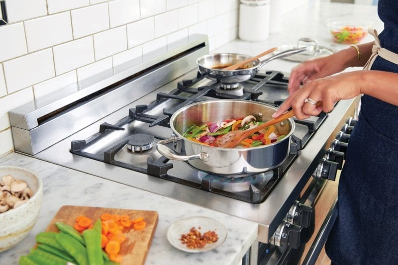stainless steel and black gas range