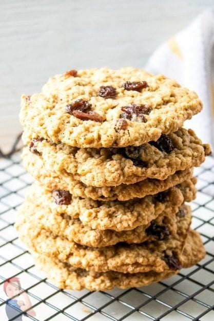 Classic Oatmeal Raisin Cookies stacked up on cooling rack.