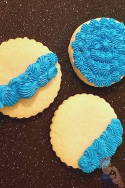 Sugar cookies in different stages of decorating with icing
