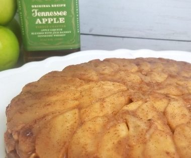 Tennessee Apple Upside-Down Cake with Jack Daniel Bottle in background