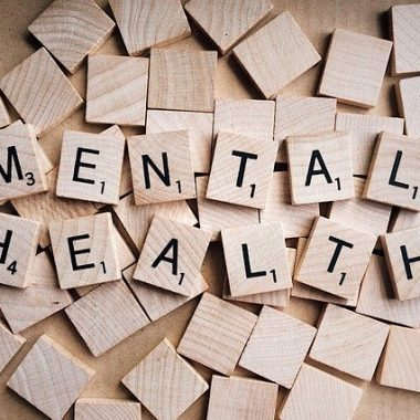 Mental Health spelled out with scrabble tiles to symbolize the ABCs of a positive mental outlook