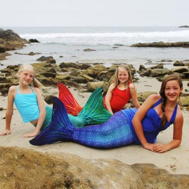 Three teen girls wearing Ocean Deep Mermaid Tail