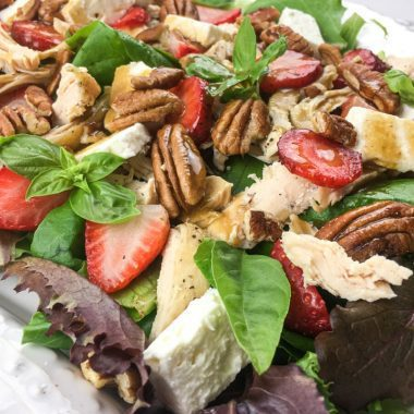 Instant Pot Chicken Salad with Strawberries, Feta, and Pecans on a white ornate plate