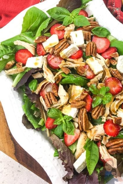 A healthy salad that tastes good - sweet strawberries, crunch pecans, and tangy feta cheese -- YUM!