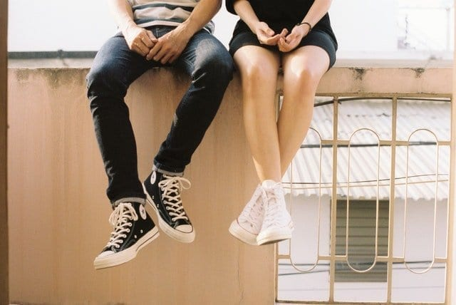 Two teens sitting on a roof top - raising a teenager can be confusing and a challenge - but there is hope!