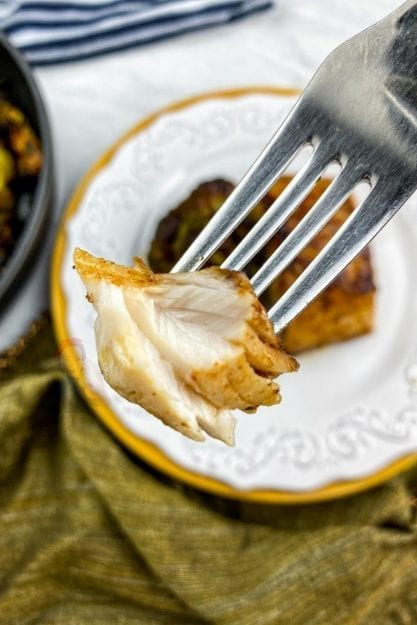 Fork holding a piece of mahi-mahi. Look at the beautiful interior!