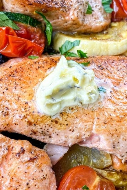 Up close view of crispy salmon with herb butter