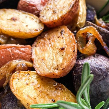 Bowl full of tri-color roasted rosemary potatoes