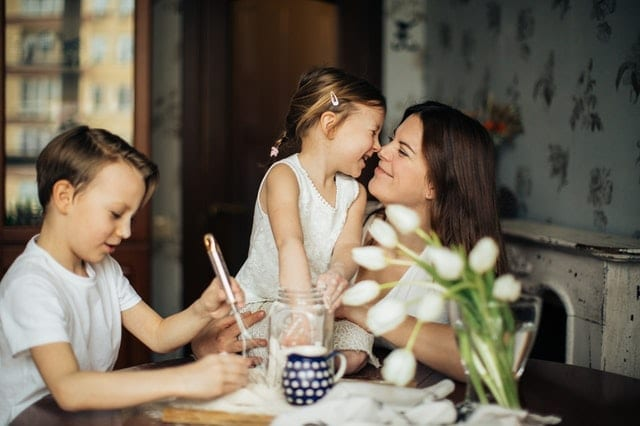 Photo of Woman Playing With Her Children in a healthy family home