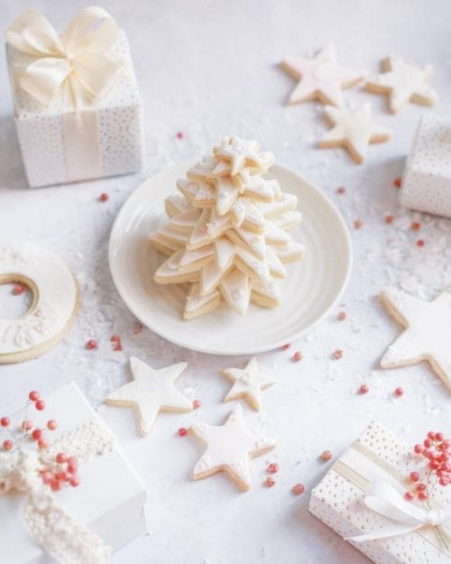 White star sugar healthier Christmas cookies stacked up like a tree surrounded by gifts
