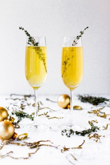 champagne flutes to toast New Year's Health Resolutions