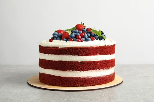 Red Velvet Cake with cream cheese icing and berries on top