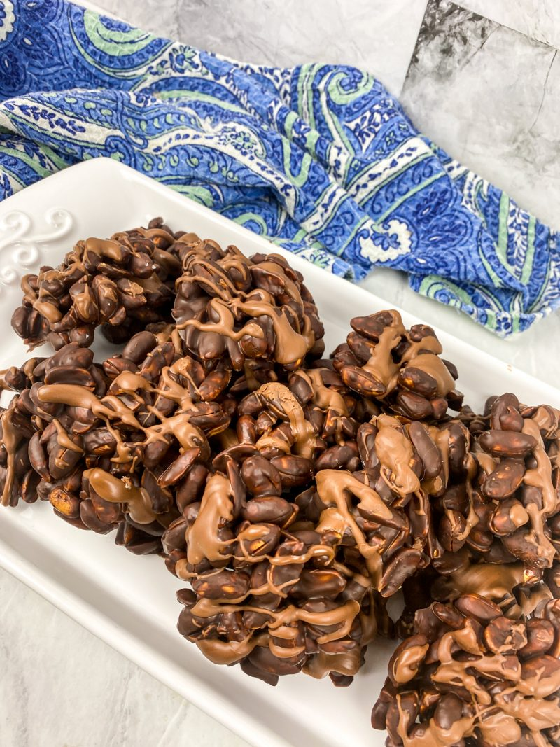 Chocolate Peanut Clusters on white serving tray