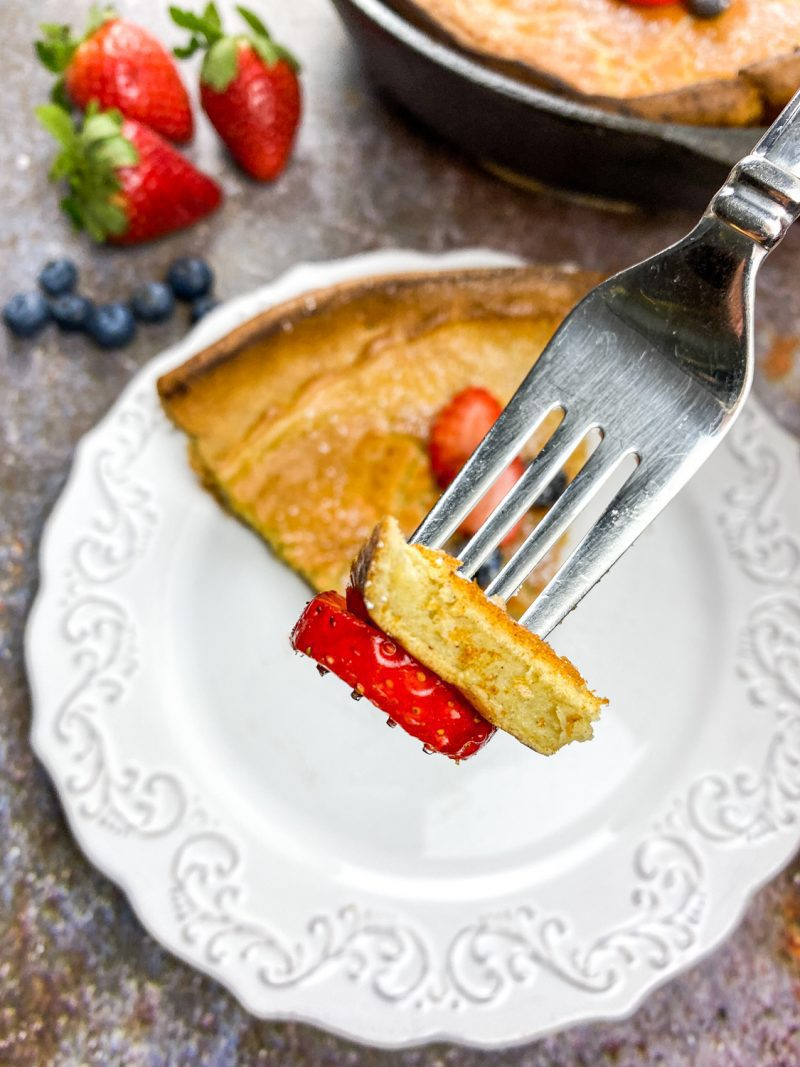 Fork holding a bite of the Dutch Baby
