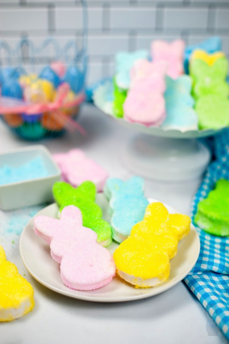 Focus image of a plate of 4 homemade marshmallow peeps covered in colored sugar