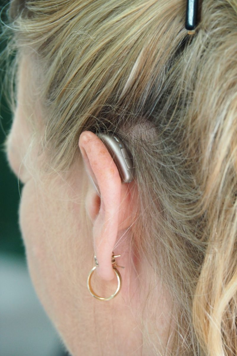 woman wearing hearing aides after suffering hearing loss