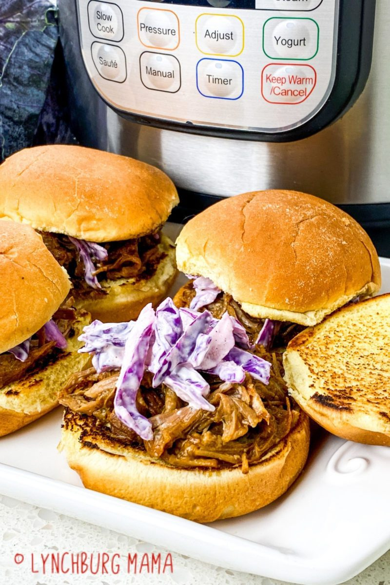 Instant Pot® Pulled BBQ Pork Sliders are sweet, tangy, and perfect for year round dinners! Top with red cabbage slaw for an extra burst of flavor!