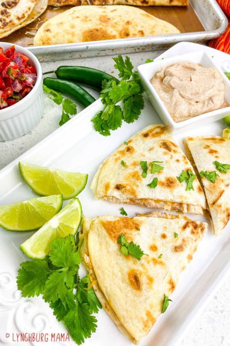 Chicken Quesadillas are an easy, tasty meal that you can use leftover rotisserie chicken in! Impress your family and have them asking for more in about 35 minutes!