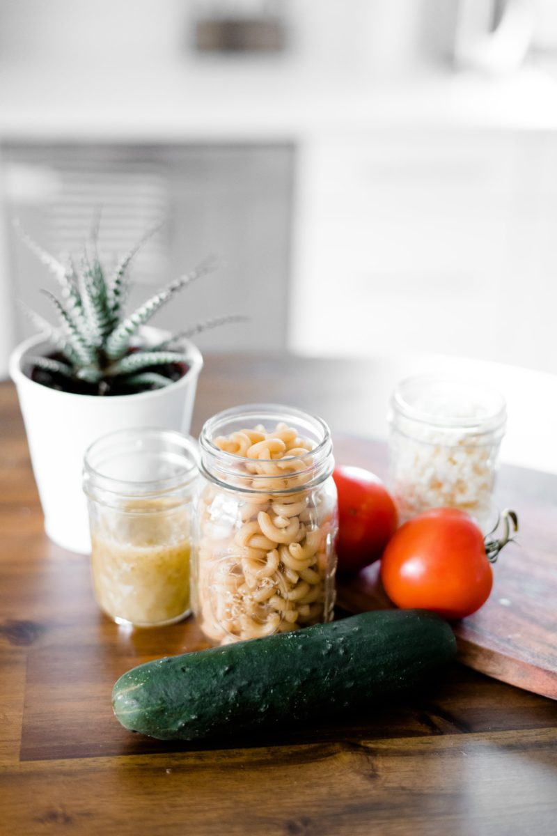 Green cucumber near jars showing how easy it is to add vegetables to your meals