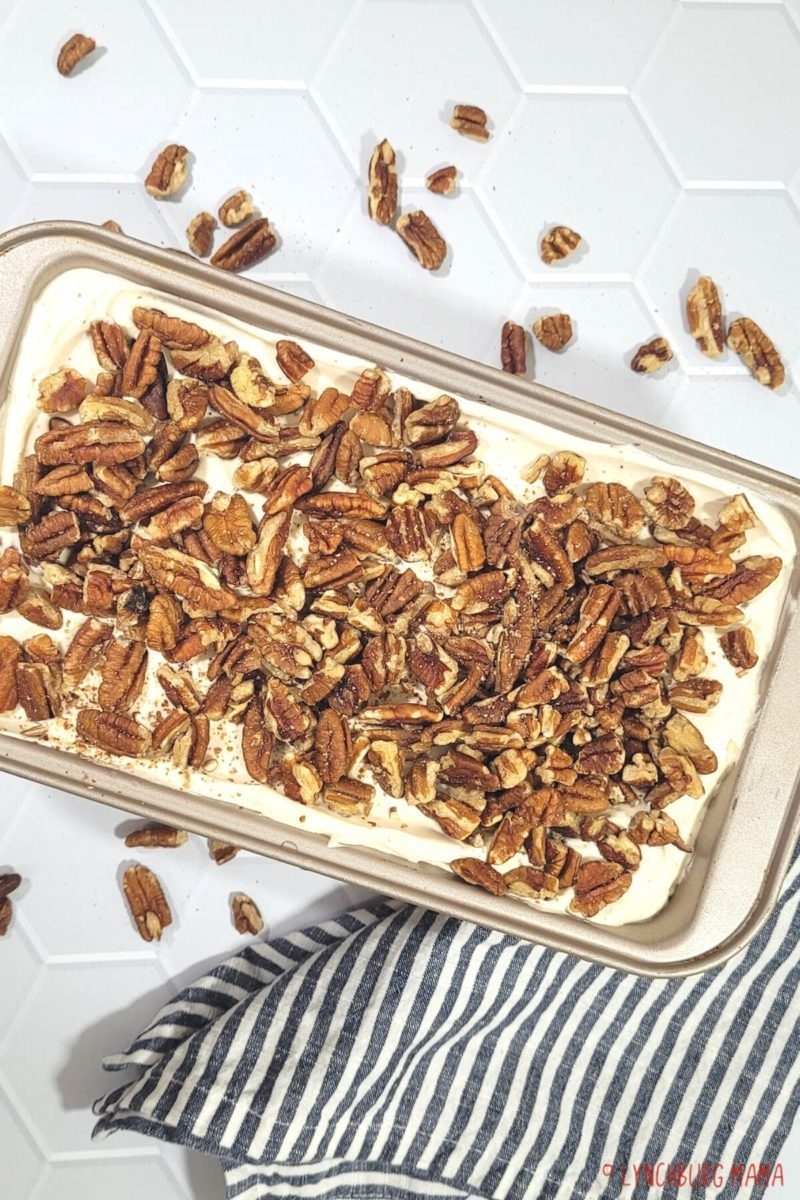 Whiskey Pecan Pie Ice Cream is a sweet, adult-ish way to cool off this summer. This easy, no-churn recipe is delicious served in a cone or a bowl!