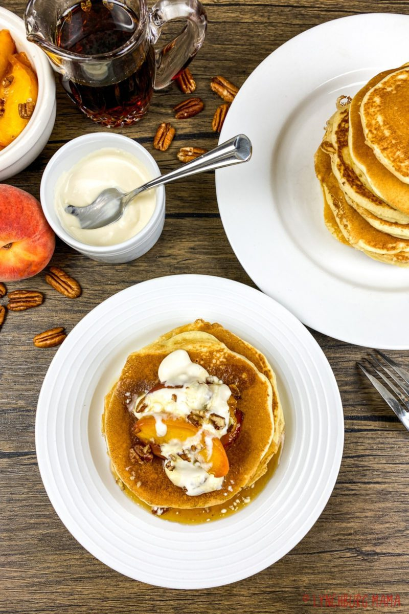 Make mornings tastier with Buttermilk Pancakes topped with peaches and cream! Add warm pure maple syrup and your family will fall in love with mornings again!