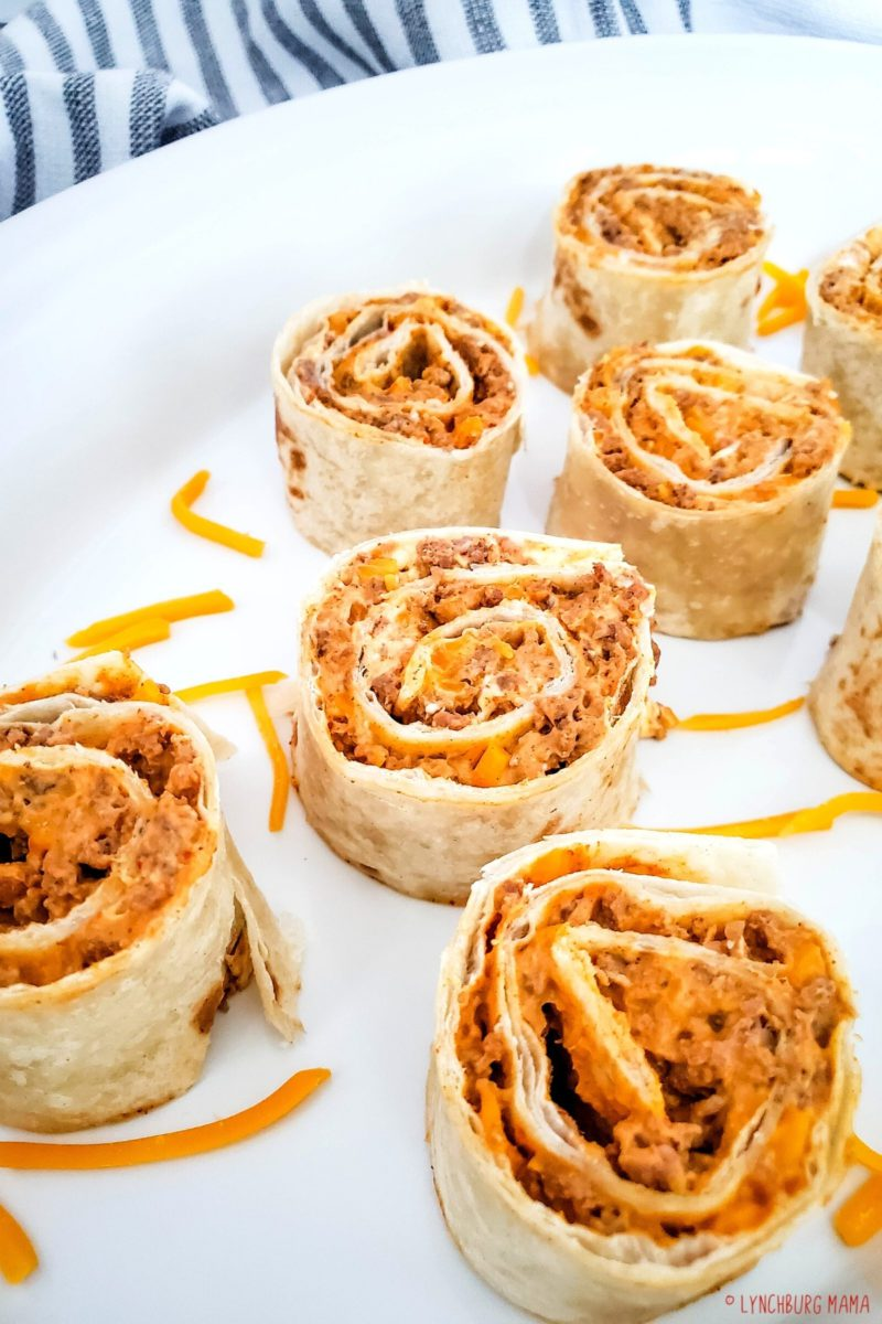 Cheesy Taco Pinwheels are table-ready in about 45 minutes. Made with ground beef, taco seasoning, and cream cheese wrapped up in flour tortillas, they're perfect for party appetizers or after-school snacks!