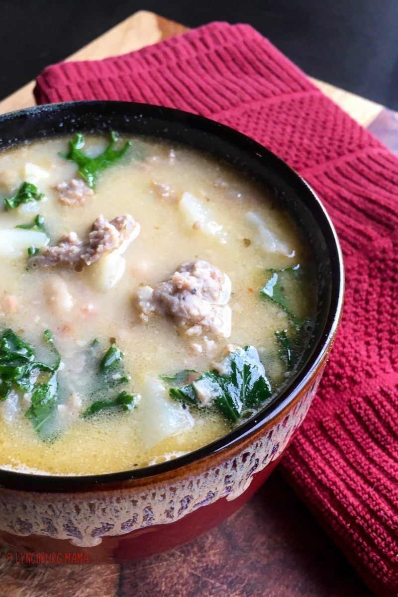Bowl of Tuscan Sausage Soup with Potatoes and Kale