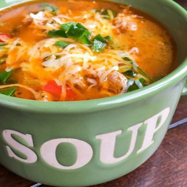 Up close view of Sausage Soup with spinach and peppers